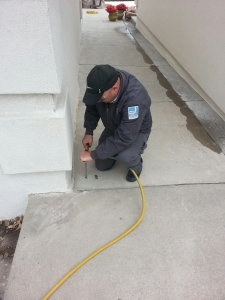 Application of termiticide below the exterior concrete slab